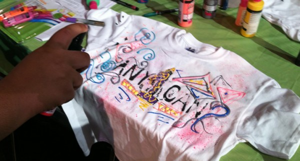 Students at area schools are hand-painting T-shirts expressing global issues they care about.